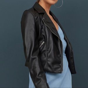 Black faux leather biker jacket with silver zipper